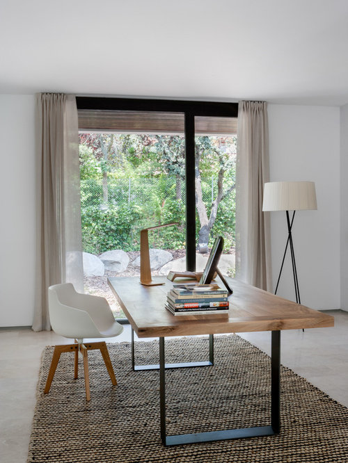 mid sized modern freestanding desk carpeted study room idea in madrid with white walls