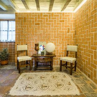 Foto de despacho clásico renovado con parades naranjas, suelo de baldosas de terracota y suelo marrón