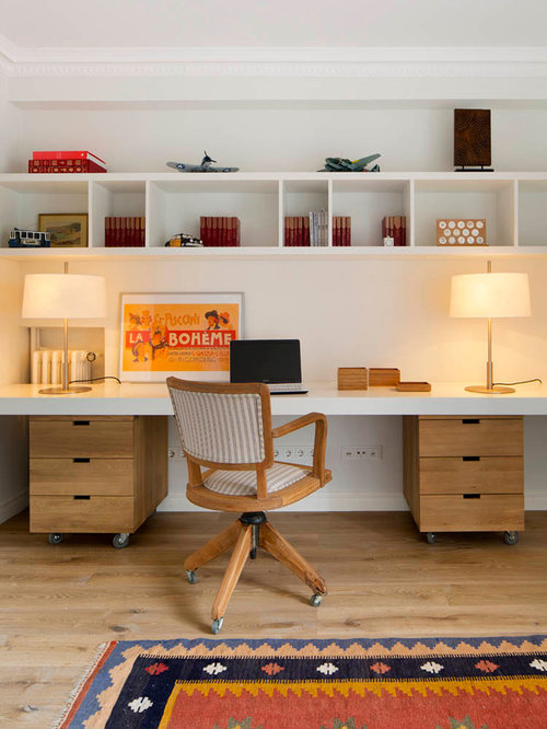 mid sized midcentury modern built in desk light wood floor study room photo in - Mid Century Modern Home Office