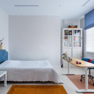 На фото: детская среднего размера в стиле современная классика с спальным местом, синими стенами, пробковым полом и белым полом для подростка, мальчика