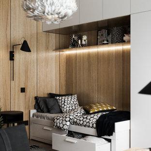 Ispirazione per una cameretta per bambini da 4 a 10 anni contemporanea di medie dimensioni con pavimento in vinile, pavimento beige, pareti beige e pareti in legno
