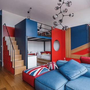 Свежая идея для дизайна: нейтральная детская в современном стиле с паркетным полом среднего тона, коричневым полом, спальным местом и белыми стенами - отличное фото интерьера