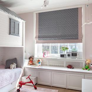 На фото: детская в стиле современная классика с спальным местом, розовыми стенами, паркетным полом среднего тона и коричневым полом для девочки
