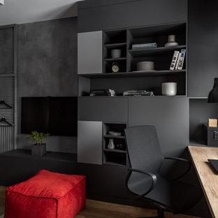 Cette photo montre une chambre d'enfant tendance de taille moyenne avec un bureau, un sol en vinyl, un sol beige et un mur gris.