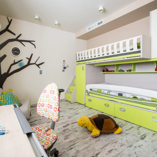 Photo of a contemporary gender neutral toddler's room in Moscow with multi-coloured walls.