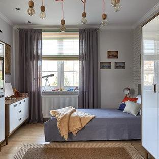 На фото: детская в стиле современная классика с спальным местом, белыми стенами, паркетным полом среднего тона и коричневым полом для мальчика с