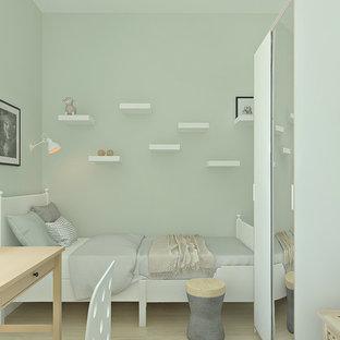 Diseño de dormitorio infantil escandinavo, pequeño, con paredes verdes y suelo laminado