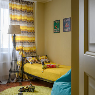Design ideas for a small transitional kids' playroom for kids 4-10 years old and boys in Moscow with yellow walls, laminate floors and brown floor.