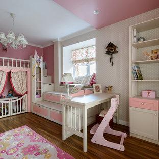 На фото: детские в стиле современная классика с игровой комнатой, разноцветными стенами и паркетным полом среднего тона для девочки, ребенка от 4 до 10 лет