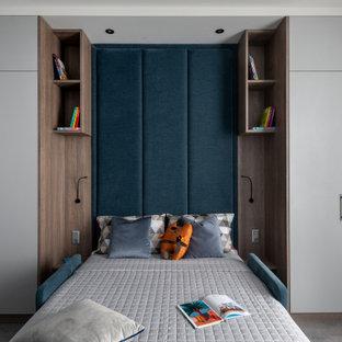 Idee per una grande cameretta per bambini contemporanea con pareti grigie, pavimento in laminato e pavimento grigio