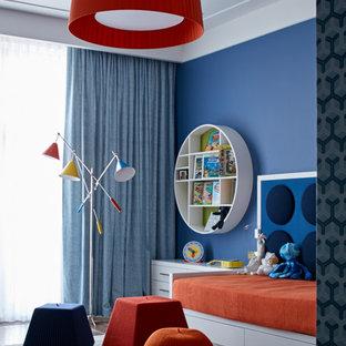 Пример оригинального дизайна интерьера: детская в современном стиле с спальным местом, синими стенами и ковровым покрытием для ребенка от 4 до 10 лет, девочки