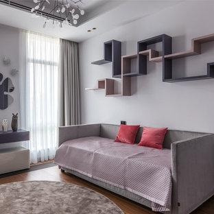 На фото: детская в современном стиле с спальным местом, белыми стенами, паркетным полом среднего тона и коричневым полом для девочки с