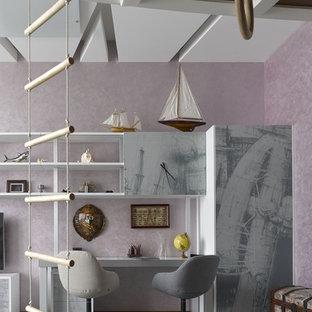 На фото: большая нейтральная детская в современном стиле с фиолетовыми стенами, рабочим местом и серым полом для ребенка от 4 до 10 лет