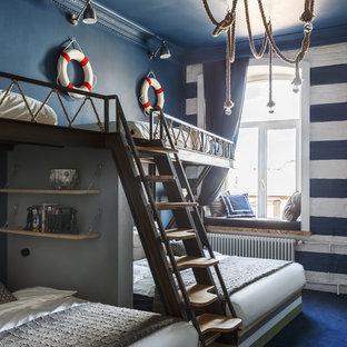 Foto di una grande cameretta per bambini costiera con pareti blu, moquette e pavimento blu