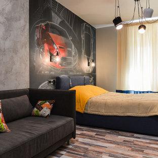 Ejemplo de dormitorio infantil actual, grande, con suelo de corcho, paredes grises y suelo multicolor