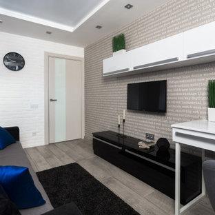 Exemple d'une petit chambre d'enfant avec un mur gris, sol en stratifié, un sol gris, un plafond décaissé et du papier peint.