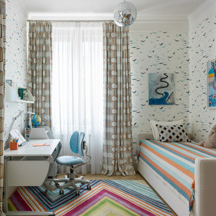 Design ideas for a mid-sized contemporary kids' bedroom for kids 4-10 years old and boys in Moscow with carpet, multi-coloured floor and white walls.