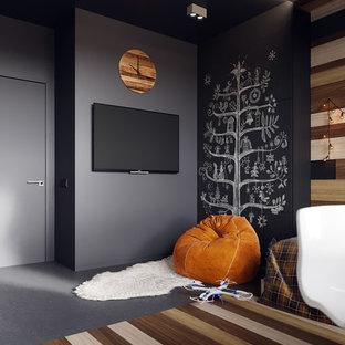 Exemple d'une chambre d'enfant de 4 à 10 ans tendance de taille moyenne avec un mur gris, un sol en liège et un sol gris.