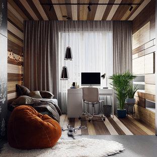 Bild på ett mellanstort funkis pojkrum kombinerat med sovrum och för 4-10-åringar, med grå väggar, korkgolv och grått golv