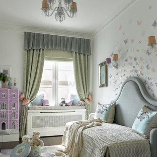 На фото: детская в классическом стиле с спальным местом, белыми стенами и темным паркетным полом для ребенка от 4 до 10 лет, девочки с