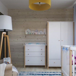 Design ideas for a medium sized scandinavian toddler's room for boys in Saint Petersburg with laminate floors.