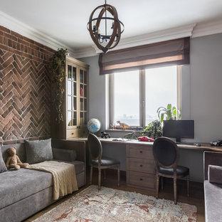 На фото: нейтральная детская в классическом стиле с рабочим местом, коричневыми стенами, паркетным полом среднего тона и коричневым полом с