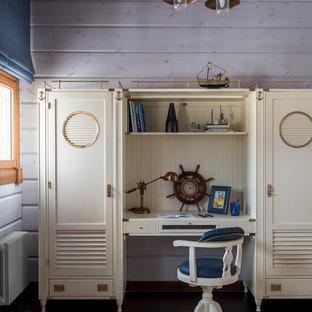 На фото: детская в морском стиле с синими стенами, темным паркетным полом, коричневым полом и рабочим местом для мальчика с