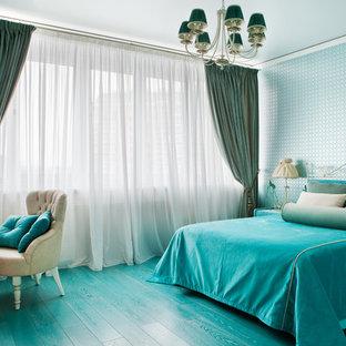 Réalisation d'une grand chambre d'enfant tradition avec un mur bleu, un sol en bois peint et un sol turquoise.