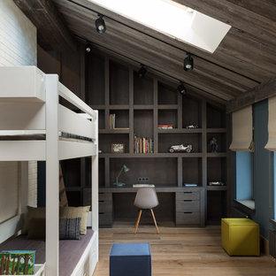 На фото: большая детская в стиле лофт с синими стенами, спальным местом, паркетным полом среднего тона и бежевым полом для мальчика, ребенка от 4 до 10 лет с