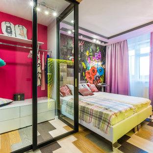 На фото: детская в современном стиле с спальным местом, розовыми стенами, разноцветным полом и паркетным полом среднего тона для девочки