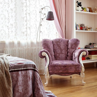 This is an example of a victorian kids' room for kids 4-10 years old and girls in Moscow with pink walls and medium hardwood floors.
