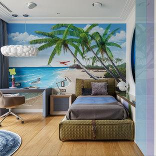 Свежая идея для дизайна: детская в морском стиле с паркетным полом среднего тона, спальным местом, коричневым полом и разноцветными стенами для ребенка от 4 до 10 лет, девочек или мальчиков - отличное фото интерьера