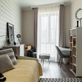 Esempio di una cameretta per bambini contemporanea con pareti beige, parquet scuro e pavimento marrone