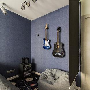 Exemple d'une chambre d'enfant tendance de taille moyenne avec un mur bleu, un sol en liège et un sol bleu.