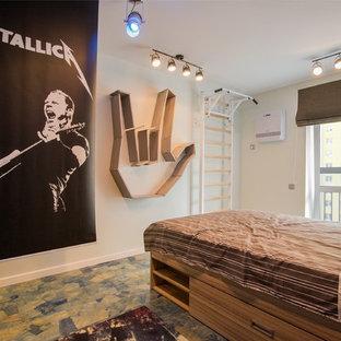 Diseño de dormitorio infantil contemporáneo, de tamaño medio, con paredes azules, suelo de corcho y suelo azul