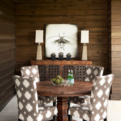 Example of a mid-sized eclectic dining room design in Other