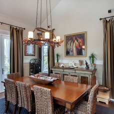 Beach Style Dining Room by Emerald Coast Real Estate Photography