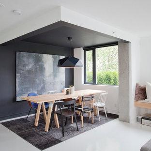Idées déco pour une salle à manger ouverte sur le salon scandinave avec un mur noir.