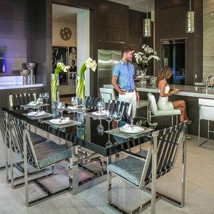 Idee per una grande sala da pranzo aperta verso la cucina design con pavimento in gres porcellanato, nessun camino e pavimento beige