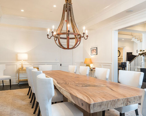 transitional dining room idea in los angeles with white walls and dark
