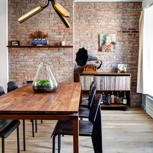 Mid-sized trendy light wood floor and beige floor great room photo in New York with red walls