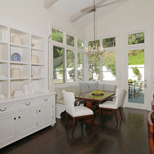 Example of a classic dark wood floor dining room design in Los Angeles with white walls