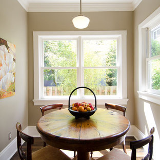 Elegant dark wood floor enclosed dining room photo in Portland with beige walls
