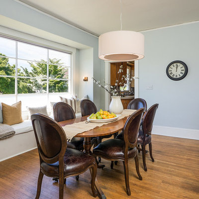 Inspiration for a timeless dining room remodel in Seattle with blue walls