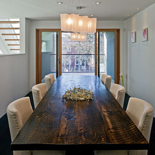 This is an example of a contemporary dining room in Toronto with white walls.
