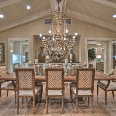 Example of a beach style medium tone wood floor dining room design in Los Angeles with beige walls