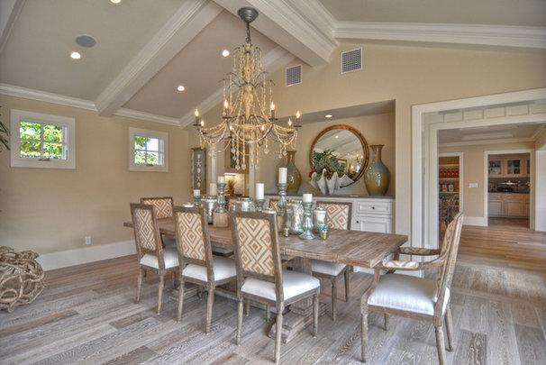 Beach Style Dining Room by Spinnaker Development