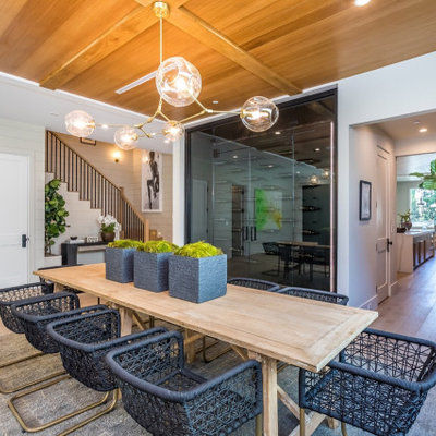 Inspiration for a large country light wood floor and beige floor enclosed dining room remodel with white walls and no fireplace