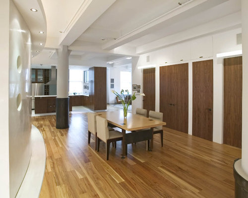 Example Of A Trendy Medium Tone Wood Floor Kitchen/dining Room Combo Design  In New