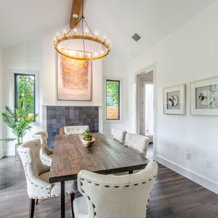 Example Of A Country Dark Wood Floor And Brown Enclosed Dining Room Design In Austin